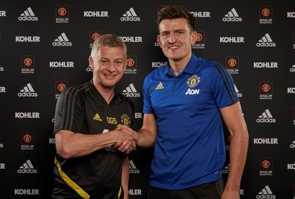 Harry Maguire and Ole Gunnar Solskjaer Manchester United